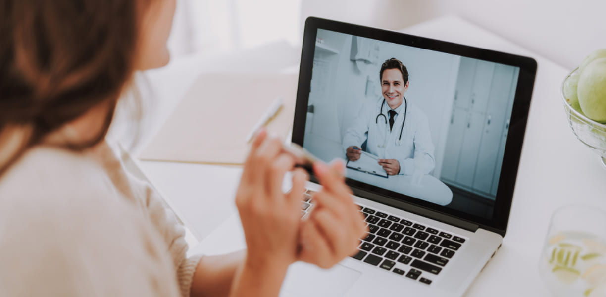 Doctor and patient making consultation through videoconference