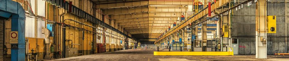 Panoramic view of the interior of an industrial warehouse.